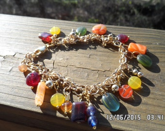 Dangle Bracelet on Gold chain with fall/winter colors and swivel lobster clasp