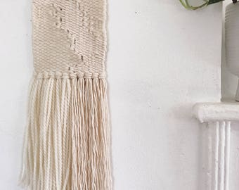 Weaving - cream woven wall hanging