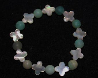 Women in mother of Pearl flower bracelet, Pearl amamazonite.