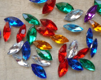 Multicolored faceted navettes set of 7 * 15mm to stick