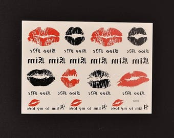 a Board 11 Kiss LOVE red and black temporary tattoos.