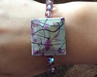 Stretch Beaded Bracelet with purple Beads and a large square Bead, Free Shipping