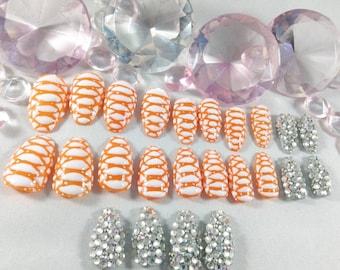 Fake nails, press on nails, snakeskin nails, bling nails, 3d nails, coffin nails, ballerina nails, orange nails, gel nails, rhinestones