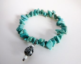 Turquoise Chips Beaded Stretch Bracelet With Silver Charm