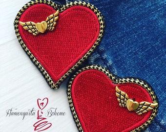 Angel's heart earrings.