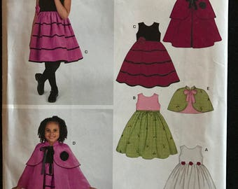 New Look 6527 - Girl's Dress, Tiered Cape, and Capelet - Size 3 4 5 6 7 8