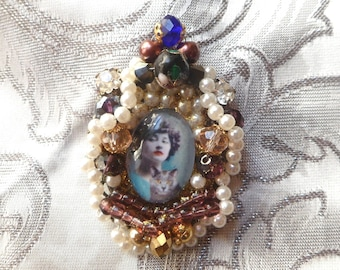 baroque brooch with Locket: Colette and Saha, the last cat