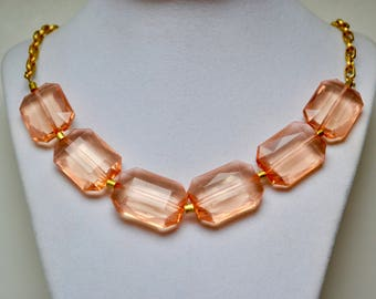 Peach faceted bead necklace