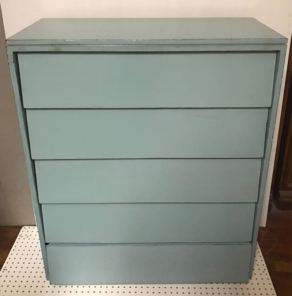 Tall blue dresser with five drawers