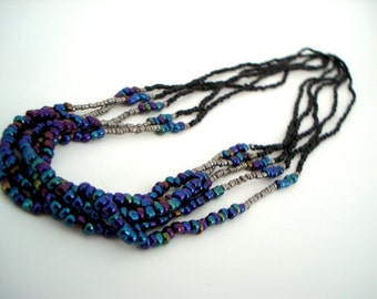 Multi Strand Beaded Necklace colorful blue and purple jewel tone, silver, and black seed bead stranded long statement necklace