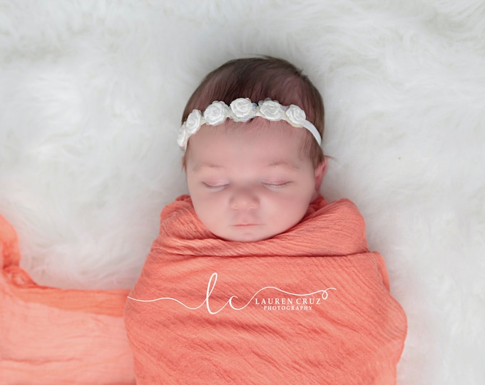 Irridescent sequins surround white satin roses on white soft stretch elastic. Perfect for a newborn! Use for photo sessions or everyday wear