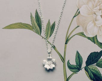 Delicate sterling silver flower pendant