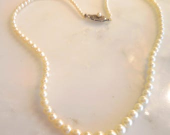 "Vintage Graduated Pearl Necklace, 17""  Graduated creamy Pearls with a Sterling Silver Clasp"