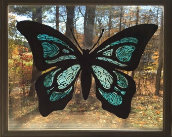 Custom made butterfly mosaic cut out on 16x20 picture frame. Window or wall hanging.