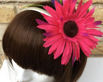 Pink gerbera headband with purple accents
