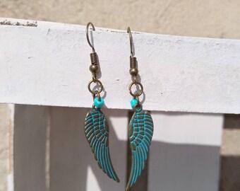 Metal earrings, wings earrings,