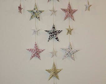 Mobile graphic powder pink wall origami stars