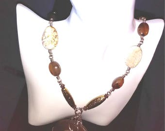 Hand Crafted Silver Stone Beaded Necklace with Ammonite Fossil Centerpiece.