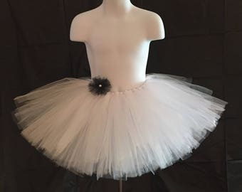 All white tutu with removable flower in your choice of color!  Pure white,  simple flower girl