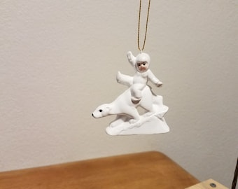Ceramic Snowbaby riding on Bears back Ornament (#849)
