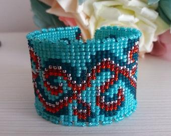 Loom beaded bracelet, cuff bracelet, curls, dark, shiny colours, red, turquoise, silver, Toho seed beads