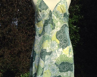 Vintage 1960s, 1970s floral patterned full slip, petticoat in shades of green. From St Michael. Lingerie, lounge wear