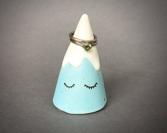 Snow mountain ceramic ring holder cone in blue