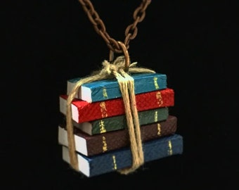 Bookish necklace: A stack of miniature vintage books tied up in string