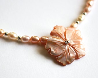 Pearl necklace with shell flower pendant in peach and white