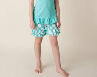 Girls teal and white polkadotted ruffle shorts