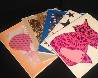 A set of five blank cards