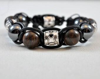 bronzite silver sculpted piece hematite leather bracelet