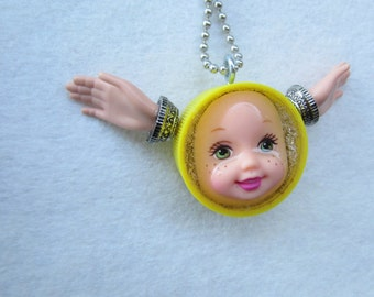 Upcycled yellow Angel Doll Face upcycled bottle cap Pendant