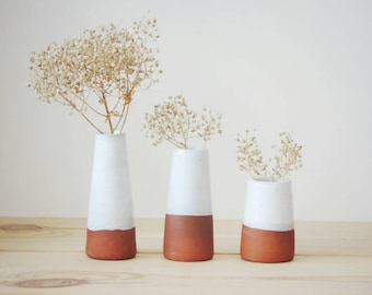 Set of 3 vases. Three tiny vases with white glaze.