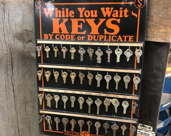 Vintage key blank hardware store display sign
