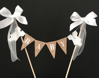 Baby shower cake topper, cake banner , cake bunting made from hessian flags with white letters & heart patterned bodysuits. Reusable