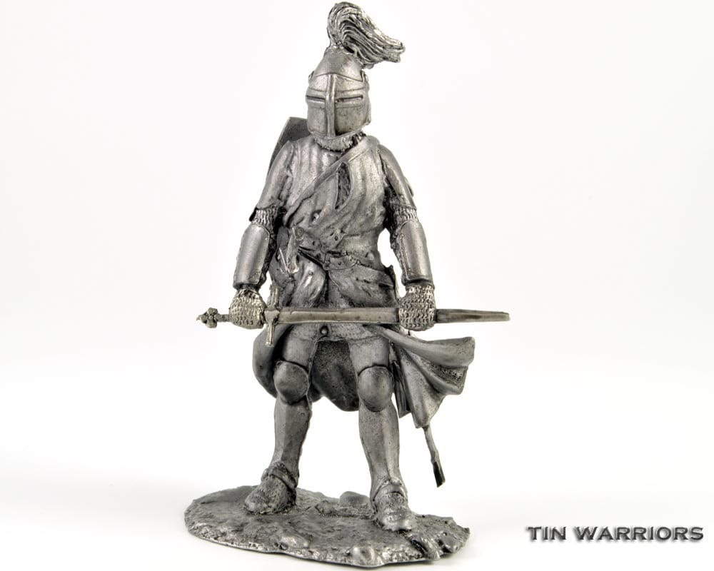 Toy soldier. Knight. Middle ages metal miniature sculpture.