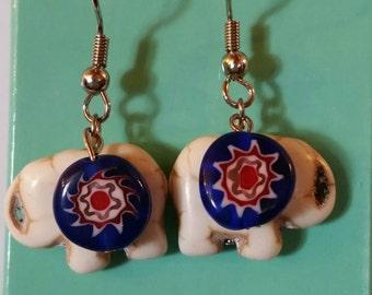 White dangle elephant earrings
