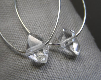 Herkimer diamond oval hoop sterling silver earrings.
