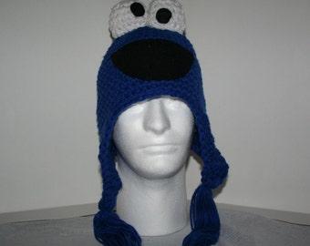 Volwassen grootte hoed handgemaakte haak karakter muts met oorkleppen en kwastjes - royal blue