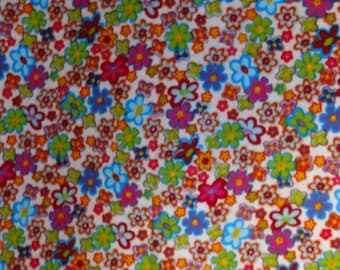 Bright Multi Colored Flowers on White Fabric by the yard