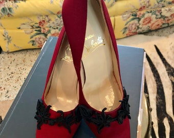 Christian Louboutin red silk pumps