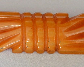 Vintage Butterscotch Orange Bakelite? Carved Bar Pin