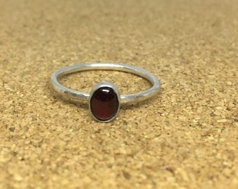 Handmade sterling silver hammered ring with a garnet gemstone