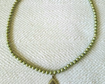Green pearl and antique style pendant.