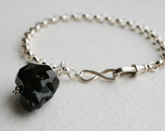 Black Crystal Skull Charm Bracelet Sterling Silver Infinity Clasp