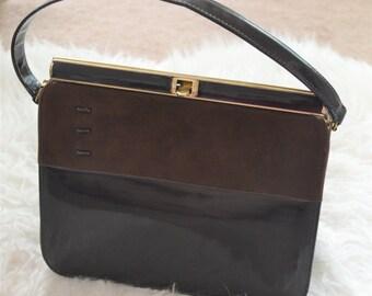 Vintage brown leather handbag with gold hardware