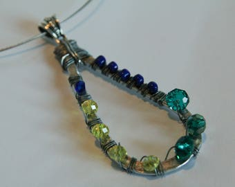 Necklace with hand-shaped drop pendant and decorated with beads.