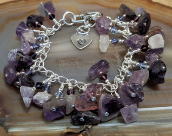 Amethyst gemstone and Swarovski crystal purple chunky cha cha bracelet chock full of different gorgeous stones and it's adjustable too!