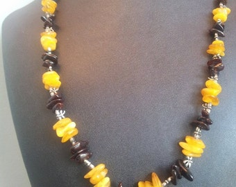 Beautiful Baltic amber in cherry and butterscotch, with pewter dragonfly beads.